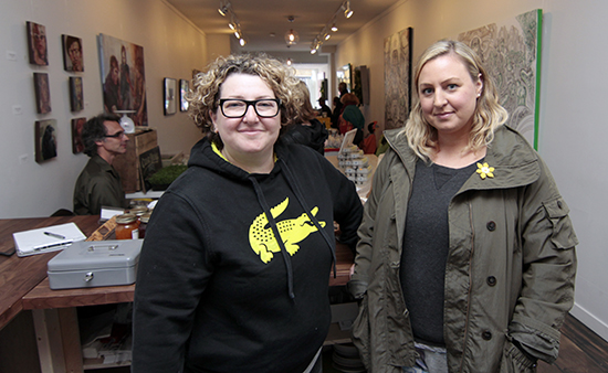 Polina Privis, left, and Tracey Kornblum stand at the counter of The Kingston Social, a new community hub they started in late April to host food markets, dinners, art, workshops, yoga, and pop-up shops on Kingston Road just west of Warden Avenue. It even has a kitchen sink. PHOTO: Andrew Hudson