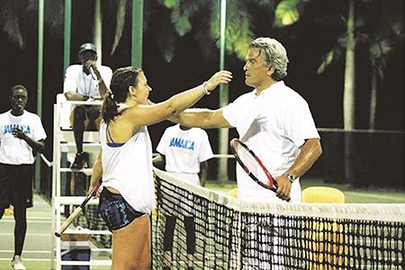Marion Bartoli, winner of the 2013 women's singles title at Wimbledon, congratulates local tennis pro Karl Hale after a benefit match in Montego Bay, Jamaica, which raised US $20,000 last month for the Helping Hands Jamaica Foundation. PHOTO: Submitted