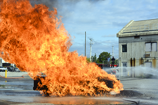 "The ""Car-B-Que,"" a simulated auto fire, blazes at the Toronto Fire Academy during the Fire Ops 101 event this summer. PHOTO: Larry Thorne"