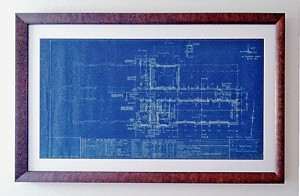 Leslieville Flea partners Brigid and author Chris Roberts took two very different approaches to presenting some old school blueprints bought from a vendor. Here, Brigid's professionally framed and matted version.