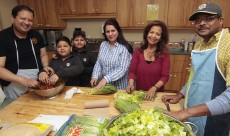 Munni Subhani, dressed in red, centre, prepares the annual thank-you lunch for settlement volunteers at the Mennonite New Life Centre with Sami Haftiz, left, brothers Shehrhan and Zarshaan Allem Hafiz, and Subhani's niece Zunaira Allem, as well as long-time volunteer chef Siva Chinniah, right.