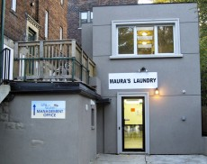 A sign reading 'Maura's Laundry' was posted above the former Squeeky Queen laundromat last fall after Maura Kilcoyne, a tenant in the attached apartment building alerted the city to the unlicensed laundry that was later shut down for violating a zoning bylaw.