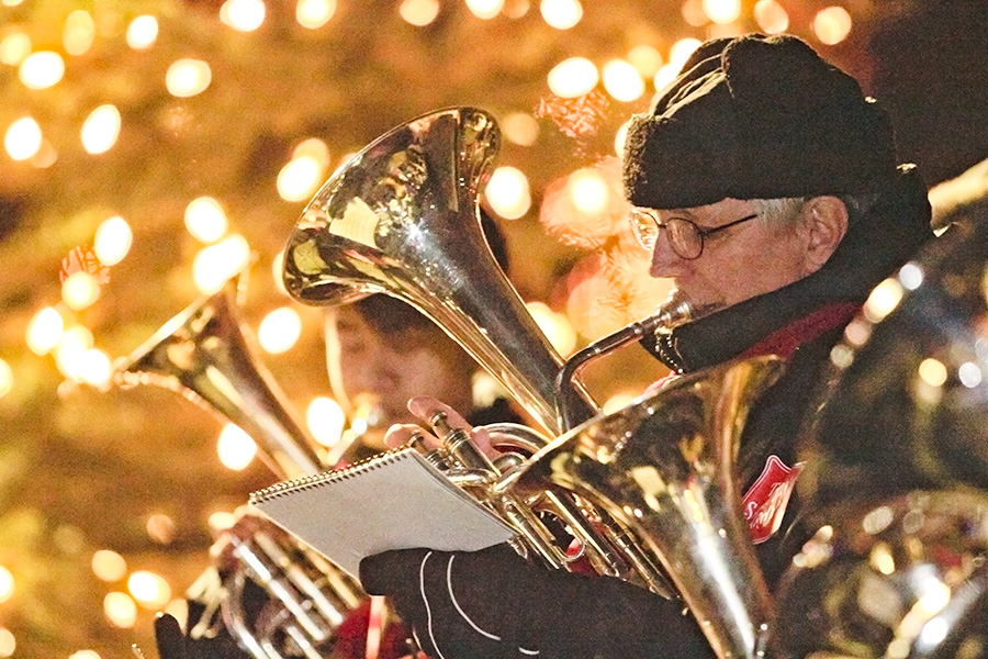 Ron Millar, front, plays baritone while Kevin Lau, rear, plays tenor horn with the Scarborough Citadel Salvation Army band, who performed several Christmas carols for Carolling in the Park on Dec. 8. Held in the Glen Stewart Ravine for 26 years, this year's Carolling brought over 300 people out on a warm December night to sing along with the brass band and drink hot cider served by local Scouts. PHOTO: Andrew Hudson