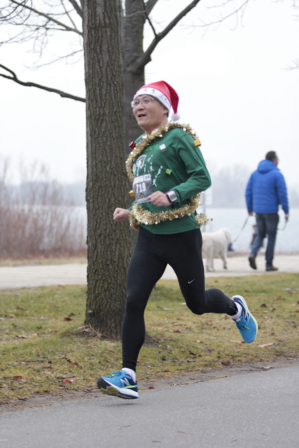 Jake Qian runs to a sparkling 39:11 finish at the Tannenbaum 10 k run held along the beaches on Dec. 6. The 10th annual benefit run, which supports Community Centre 55's Share-A-Christmas program, drew a record 984 participants who ran or walked the return course from Kew Beach to Tommy Thompson Park. PHOTO: Andrew Hudson
