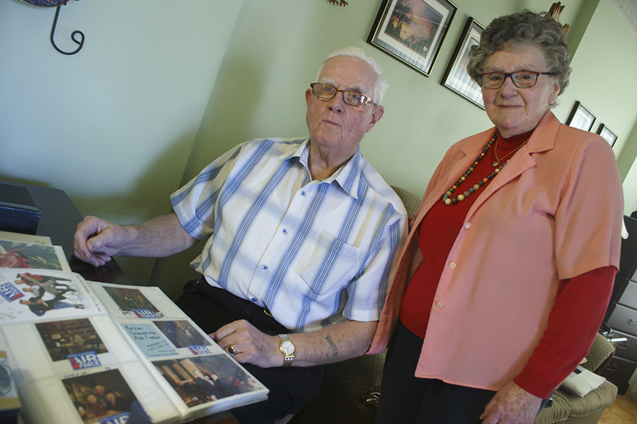 Bill and Mary Hall take a look through some of Bill's often metaphorical photographs at their home Jan. 18.
