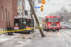 Kingston Road at Main Street was closed after a TTC Wheel-Trans bus struck a man walking his dogs, sheared off a hydro pole and then struck a building. The man, and his dog, were seriously injured, and the second dog succumb to its injuries.