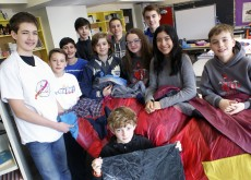The Glen Ames Garment Grabbers show off the all-in-one sleeping bag they created for the First Lego League robotics tournament. The close-knit team, which designed the waterproof and fireproof sleeping bag for a local homeless shelter, is heading to provincial championships this weekend, hoping to qualify for internationals.