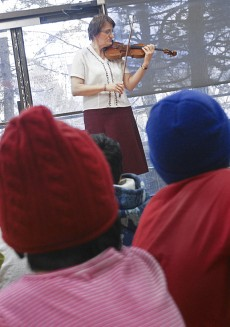 Devorina Gamalova visited the Crescent Town Club Thursday, Feb. 11, performing several songs on an 18th century violin for the Crescent Town Kick Start after-school club.