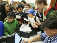 Bowmore Road Public School Grade 5 student Eddie Dunlop -- in the Toronto Blue Jays cap -- watches the results screen with dozens of other eager Scrabble players during the city qualifiers at Bowmore March 8.
