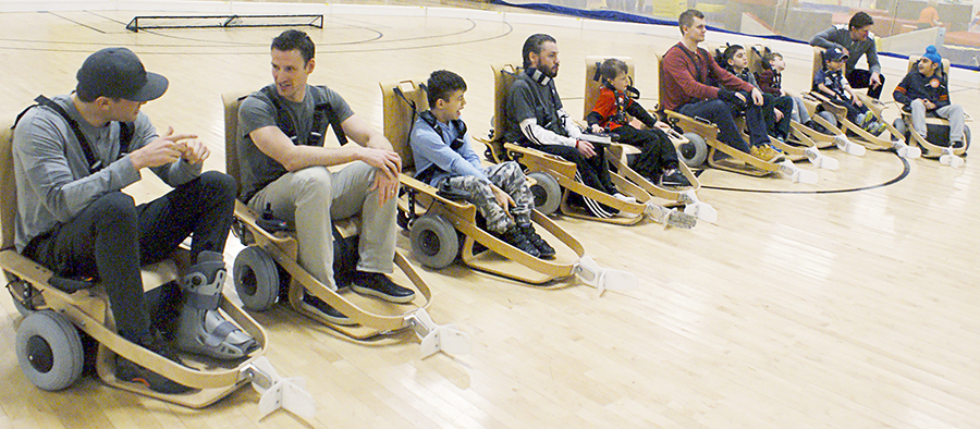 Members of the Toronto Maple Leafs organization joined Variety Village athletes March 16 to give the charity's new volt hockey chairs a spin.