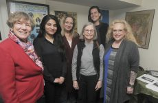 Canadian Voice of Women for Peace members at the outfit's new Beach office on Kingston Road near Main Street. On the far left is VOW co-chair Janice Alton, and on the far right is executive director Sandra Ruch.