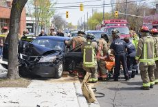 Toronto, CAN, 11 May 2016 - Kingston Road was closed at Warden Avenue after a car mounted the sidewalk and struck a tree trapping the driver and injuring 3 passengers, including an infant.