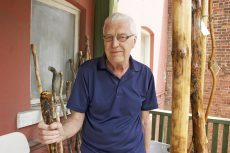 Robert Bertram, purveyor of unique hiking sticks, on his Queen East balcony June 16, 2016.