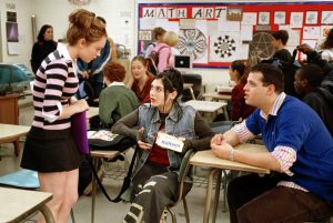 "Lindsay Lohan, Lizzy Caplan and Daniel Franzese in a scene from 'Mean Girls', filmed in the Beach and released in 2004. The movie's signature quote, ""you can't sit with us,"" has been flipped to provide the theme for the first-ever Pride Month: ""You can sit with us."""