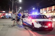 JUL/13/2016 - TORONTO, ON - Police tend to the scene of a knife attack in the Queen Street East and Coxwell Avenue area. Two victims were transported to hospital, one with serious injuries. John Hanley/FREELANCE