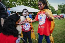 Iniya Thivaharan, 6, and her brother Saanron, 4, check out Tobey, team mascot of Cynapsus Therapeutics Inc.