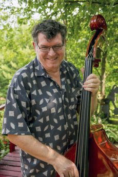 Mike Loghrin, diagnosed with Parkinson's when he was 50, has been playing the upright bass for 30 years.