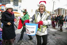 Toronto, CAN., 22 Nov 2015 - The Village of East Toronto's Christmas Parade made its way  along Kingston Road to Community Centre 55 on Main Street as families caught flying candy canes.