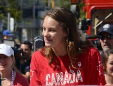Penny Oleksiak rides in a convertible during the East End parade to welcome her home August 28. PHOTO: Peter C. McCusker