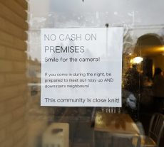 A sign taped to the door of Grinder on Main aims to deter potential thieves from attempting to break in to the premises.