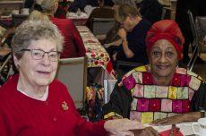 Lottie Hainey and Madeleine Mariano enjoy Neighbourhood Link's annual Christmas dinner, December 6.