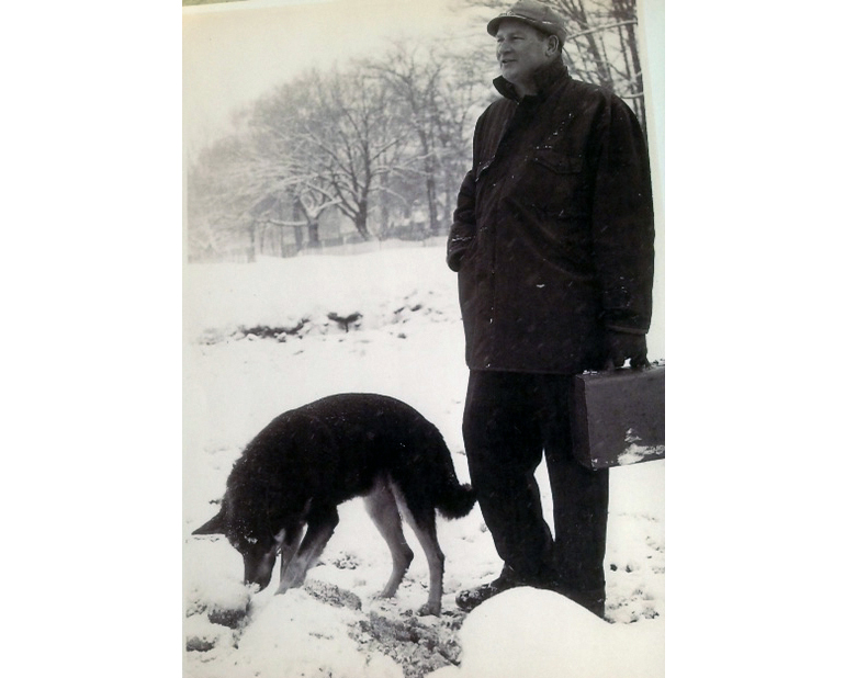 """George """"Joe"""" Davis with his dog, Duke. The case in his hand carried his camera and lens."""