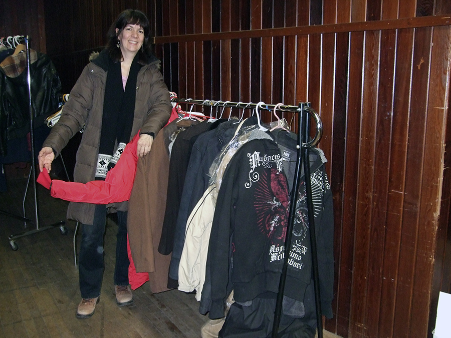 The author with her mini clothing drive of 11 winter coats (and 5 hats, 4 scarves, 3 pairs of gloves, 1 pair of winter boots) for the Out Of The Cold program at Eastminster United Church, winter 2015/16.