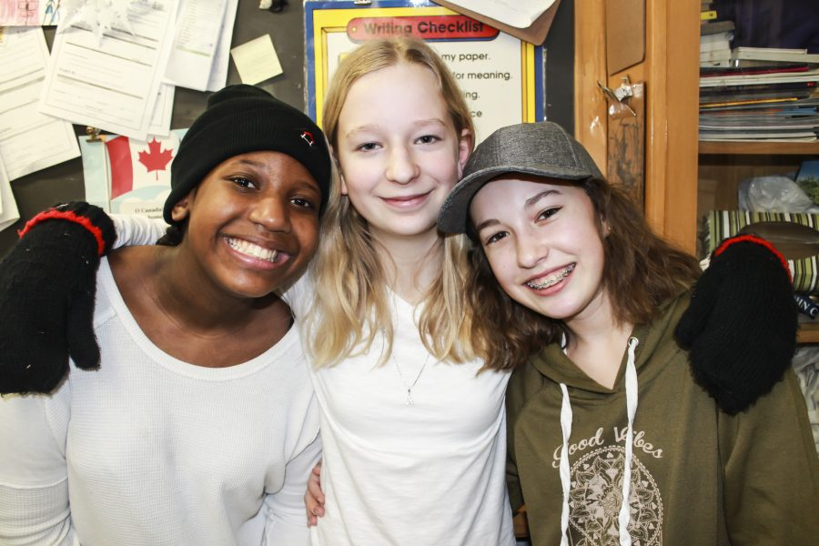 Alyssa Delvante, Ainslie Gerald and Alex Mackay show off their Raising the Roof gear during Toque Tuesday at St. John Catholic School, February 7.