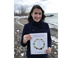 Sophie Stevens shows off her female empowerment cookbook, Good Recipes, Great Women.